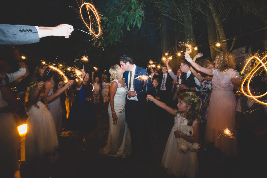 Night time sparkler photograph at wedding by Caroline Mc Nally at Wild Things Wed Photography