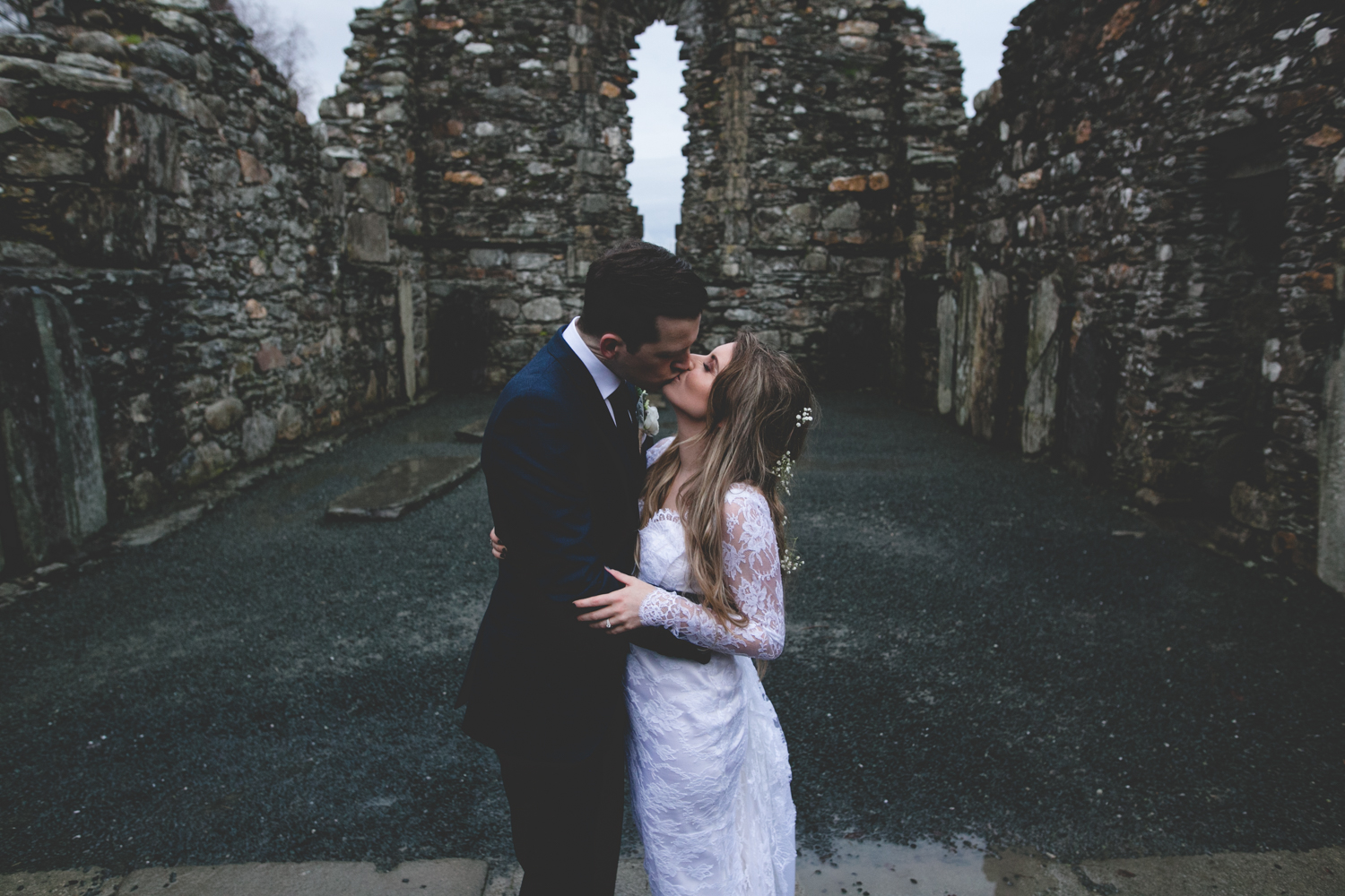Sarah and Mark's couple portrait session in the ruined church in Glendalough