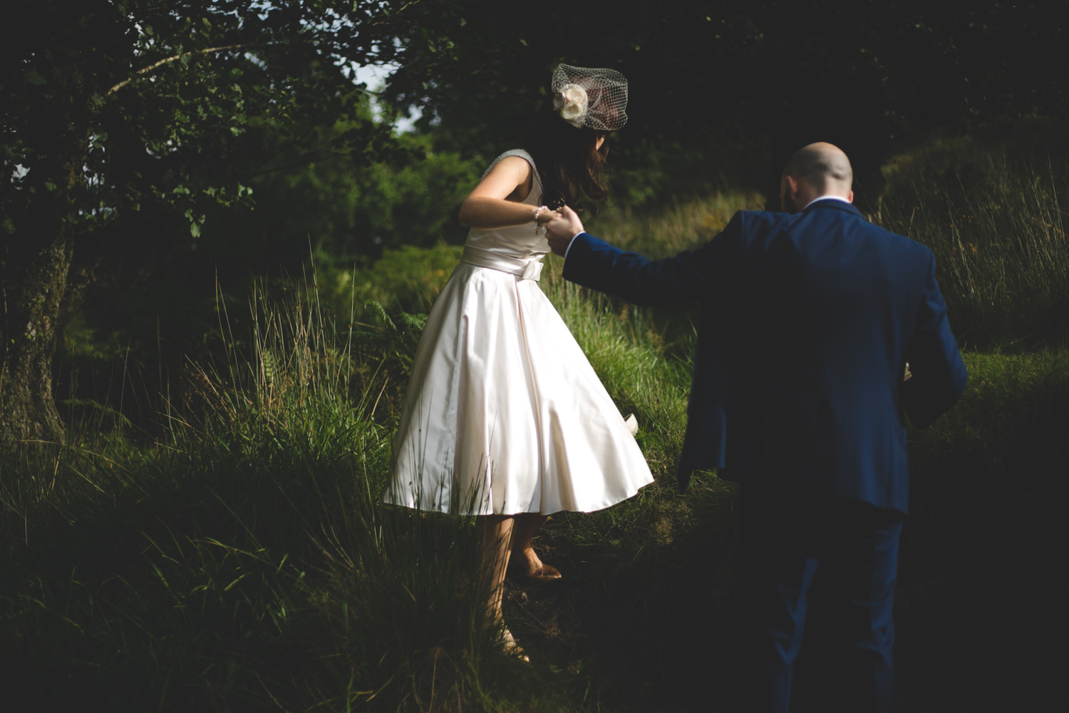 Couple tramp through woods for their wedding photos in Wicklow mountains