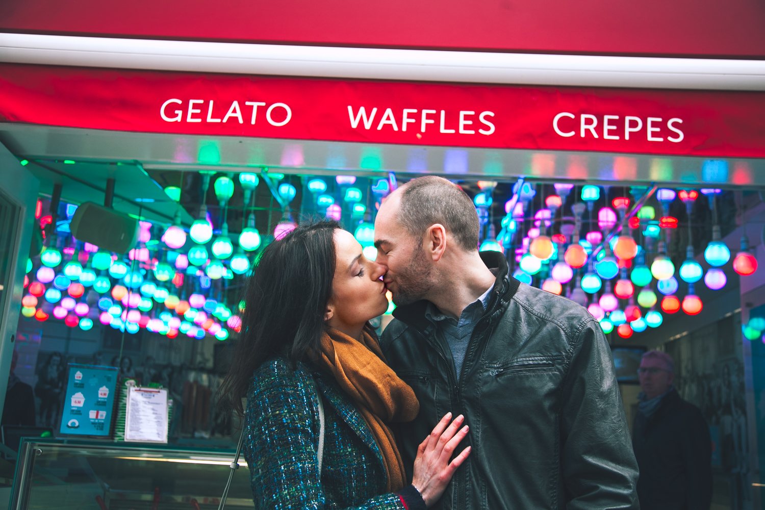 Couple kiss on engagement shoot in Dublin City centre in from of ice-cream and gelato stand