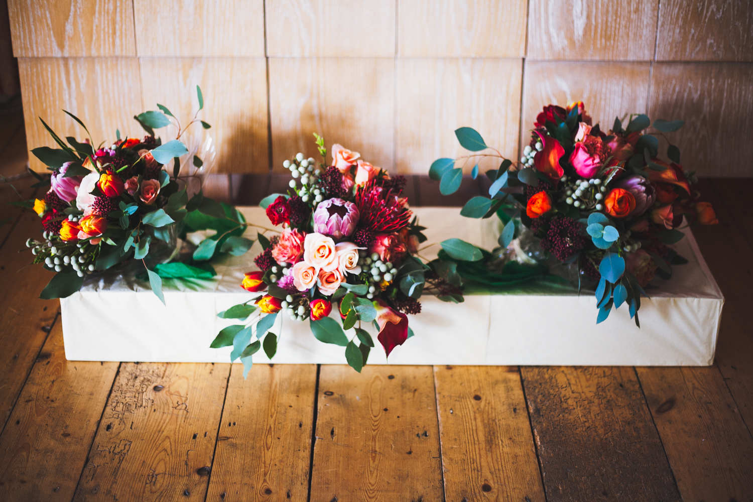 beautiful bright pink, red, purple and dark green winter wedding bouquets