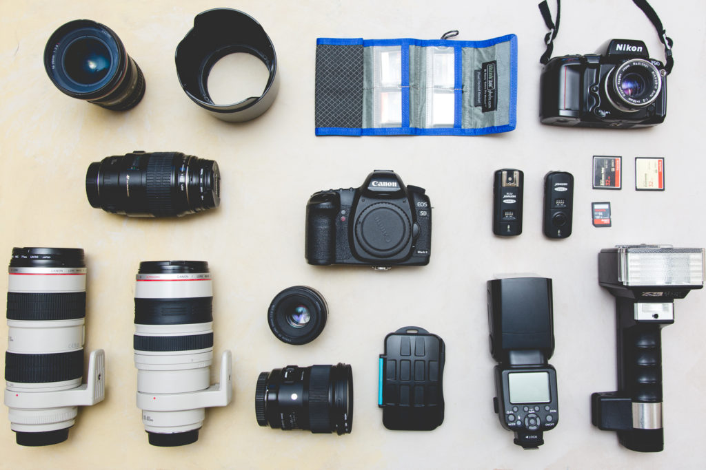 Overhead flat-lay of camera equipment for Frequently Asked Questions