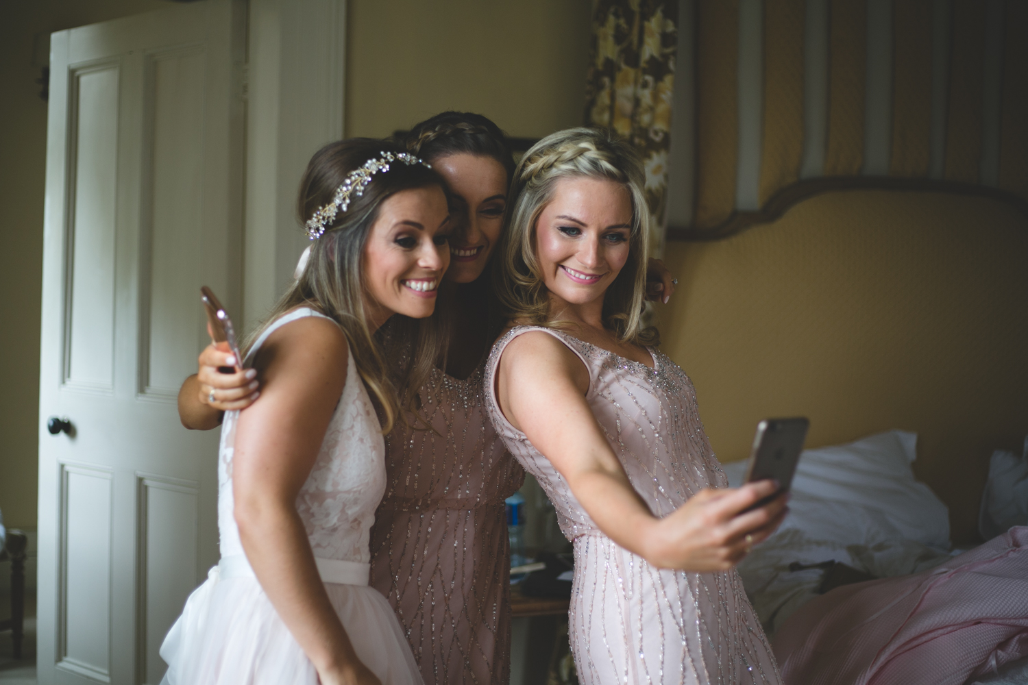 Bride and bridesmaids take group selfie at Lisnavagh House