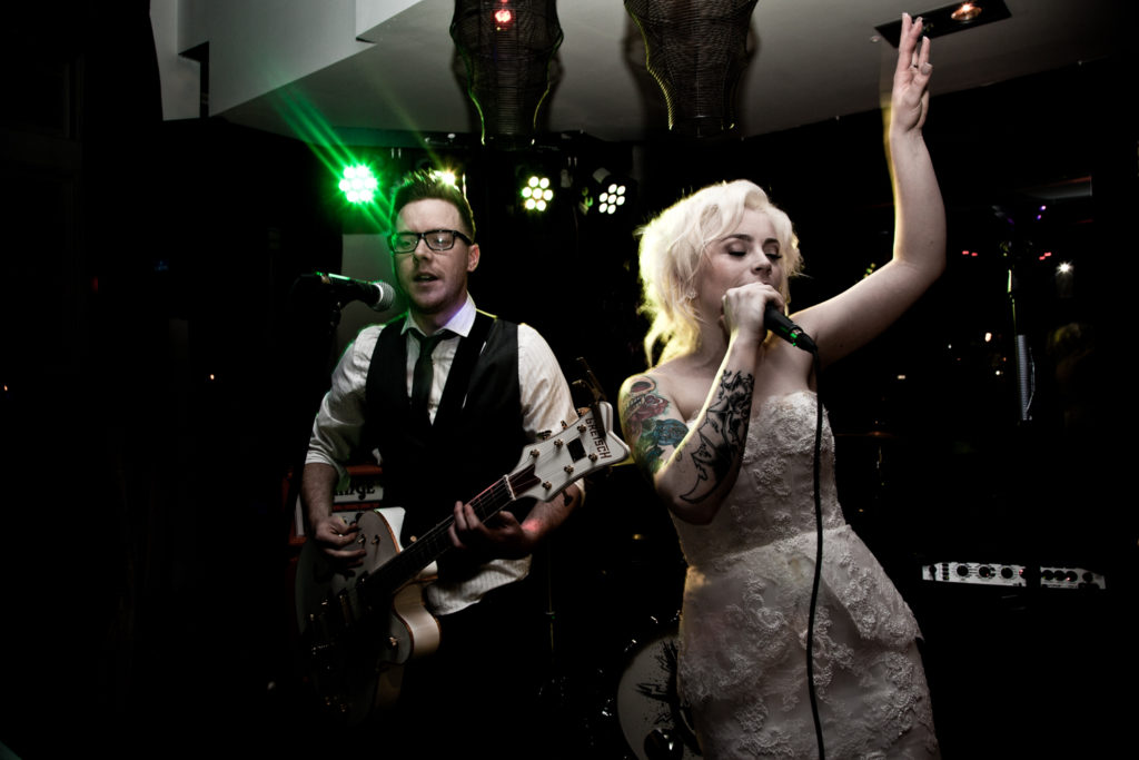 Bride sings with the wedding band at Findlaters in Howth