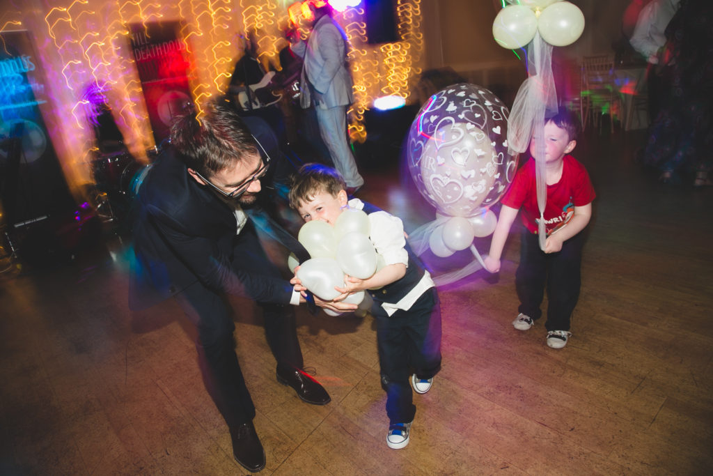 Father and son partying at wedding