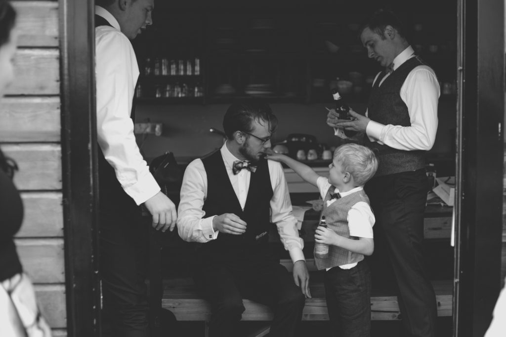 black and white images of groomsman