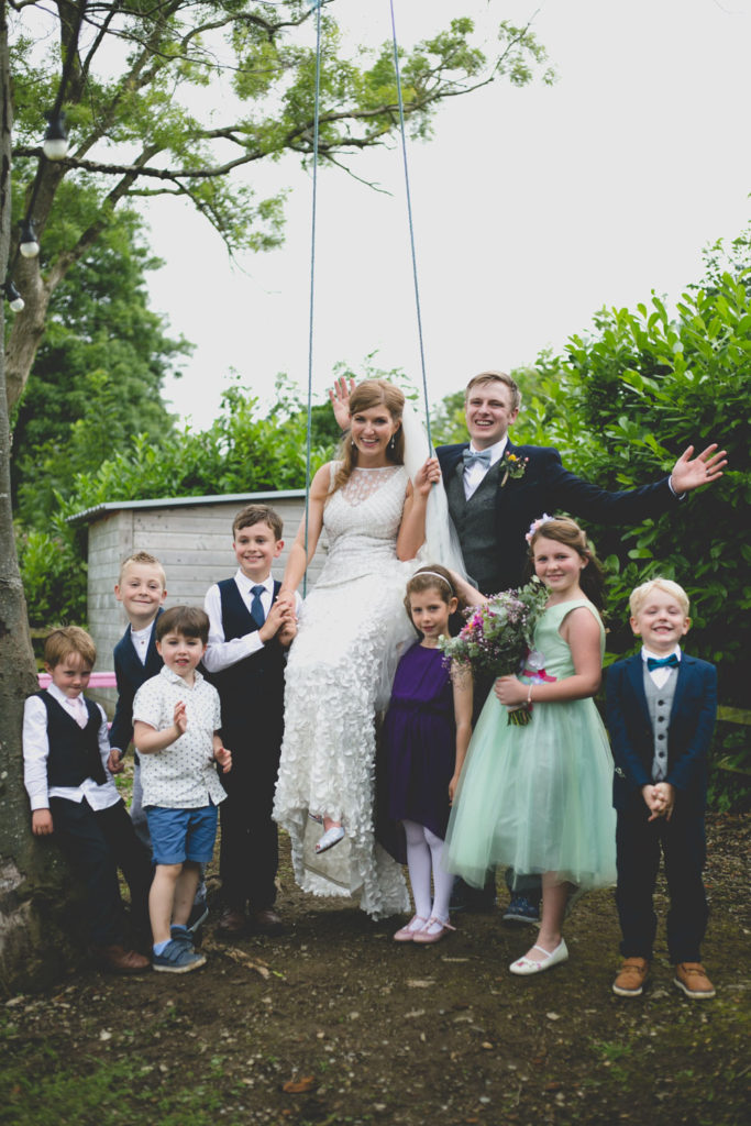 Group wedding portrait with children, flower girl and page boy
