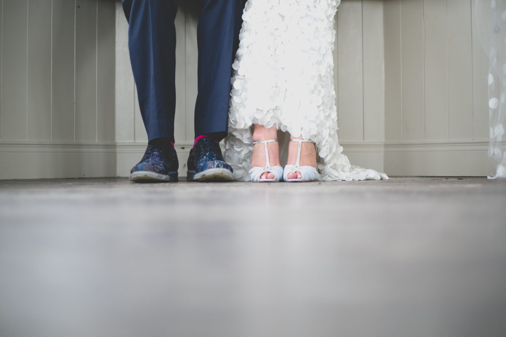 detail shot of bride and grooms shoes