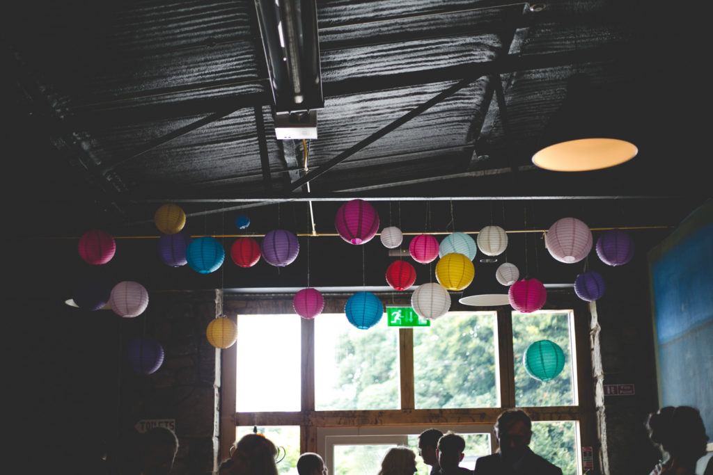 Multicoloured paper lantern display hanging from ceiling