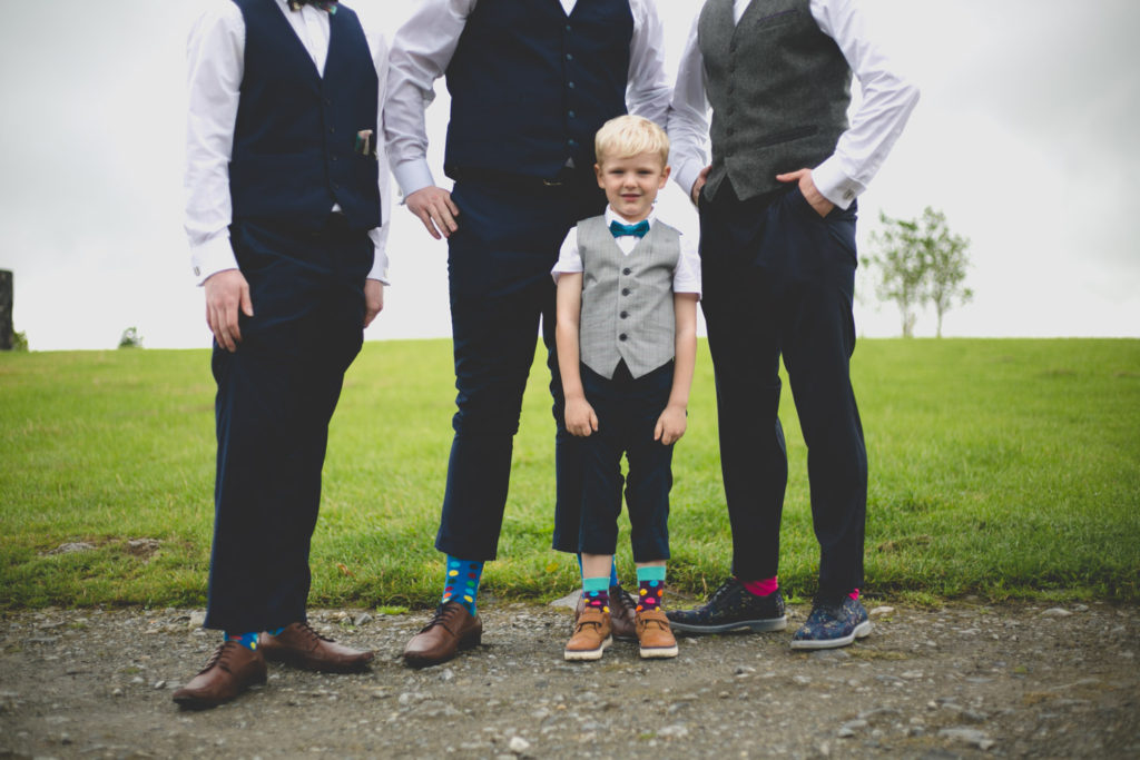 groomsmen show off their jazzy polkadot socks