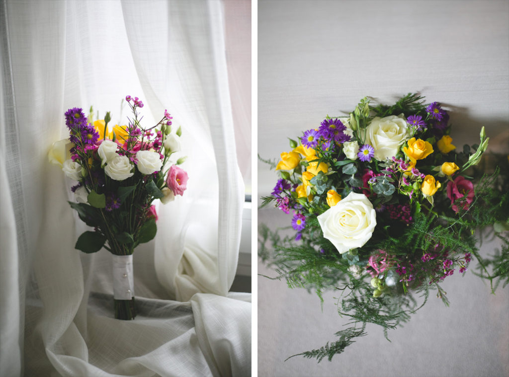Bridal bouquets with white roses, ferns and purple sprigs