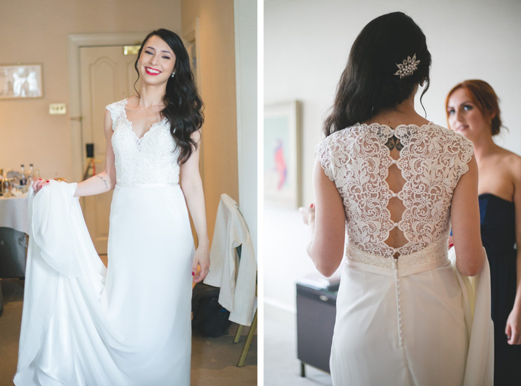 bride in lace detailed long silk white dress with red lip