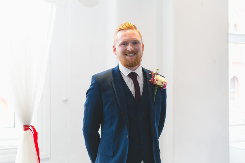Groom in petrol blue suit