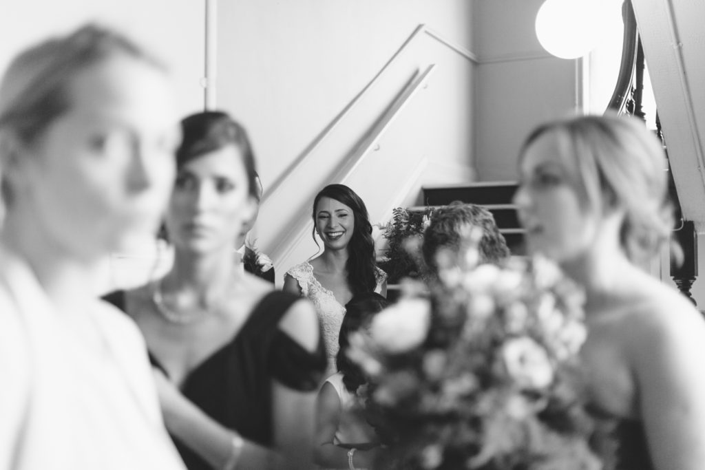 Bridal party arriving at ceremony in monochrome