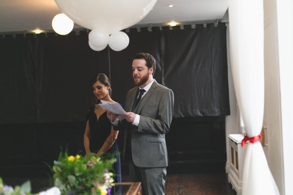 best man reading during civil ceremony