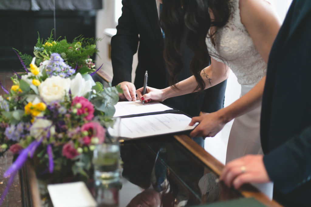 signing the registry at civil ceremony