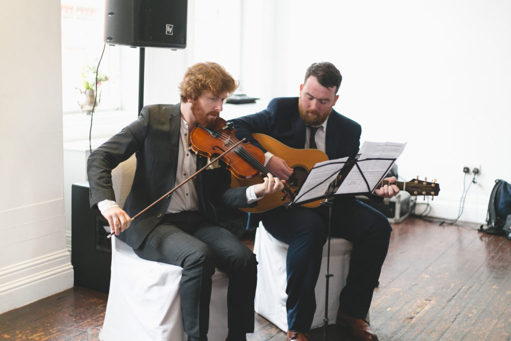 Violinist and guitarist playing music during wedding ceremony at Fallon&Byrne