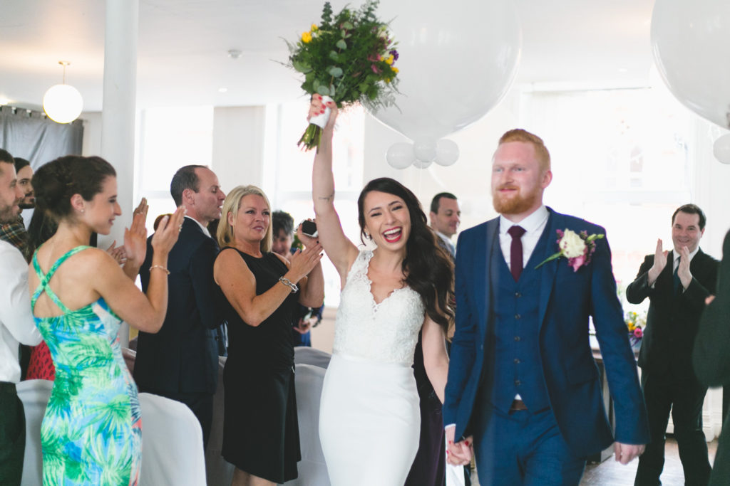 cheering coming down the aisle
