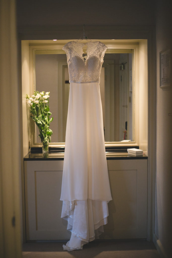 Beautiful floor length sleeveless white wedding gown with lace bodice