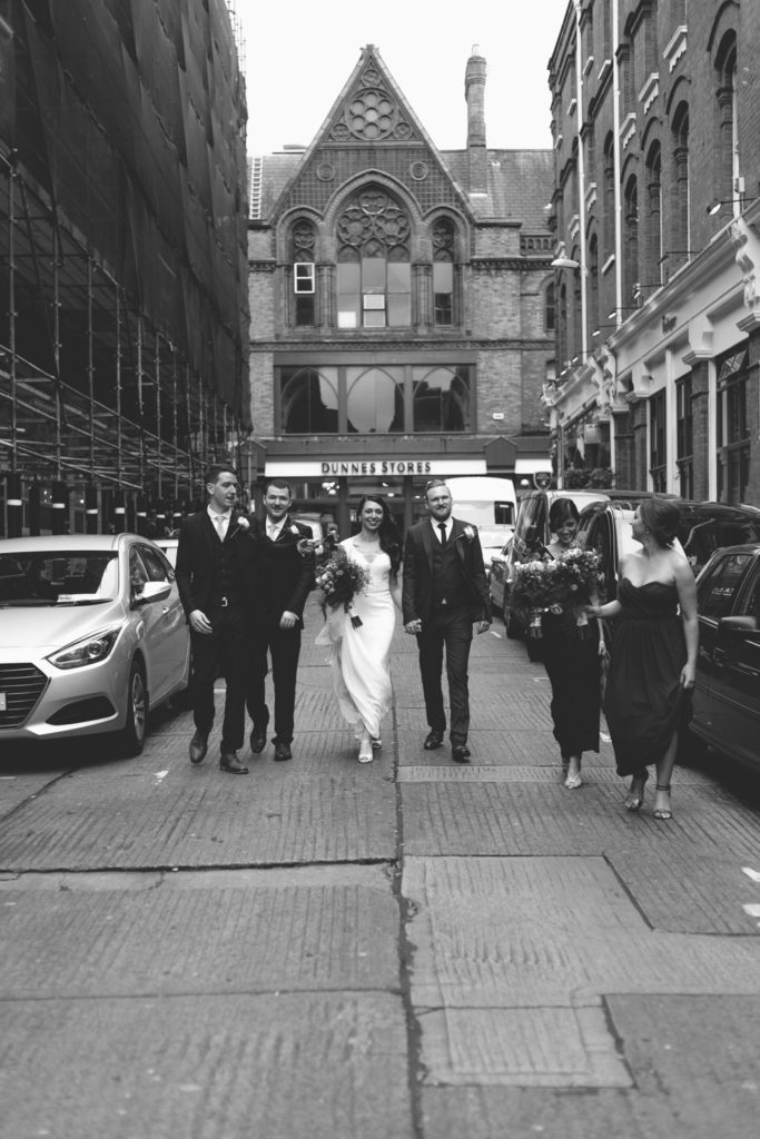 Black and white bridal party photograph on Dame Court