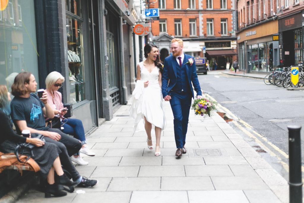 couple stroll down Drury Street