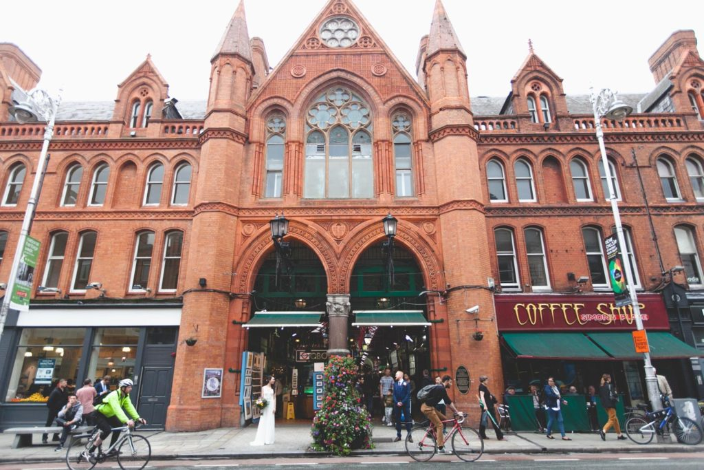 Georges street market arcade with bride and groom posing in archway