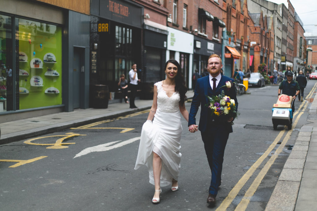 just married couples stroll down Drury street