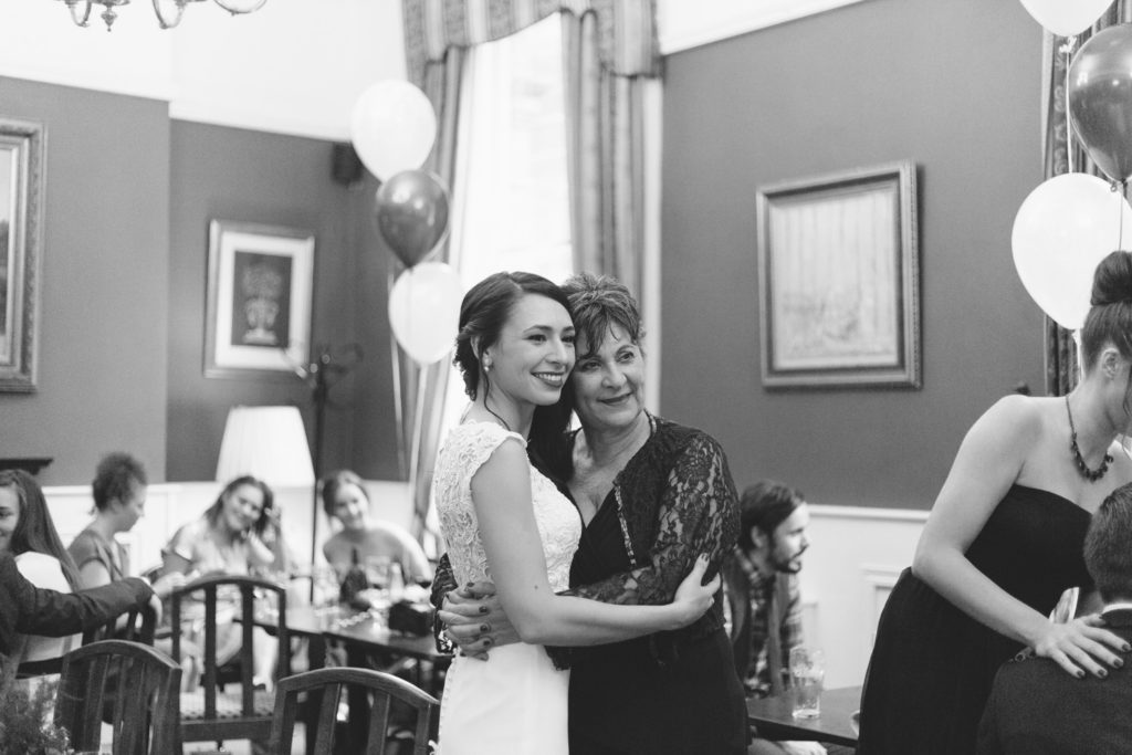 mother and daughter hug in monochrome