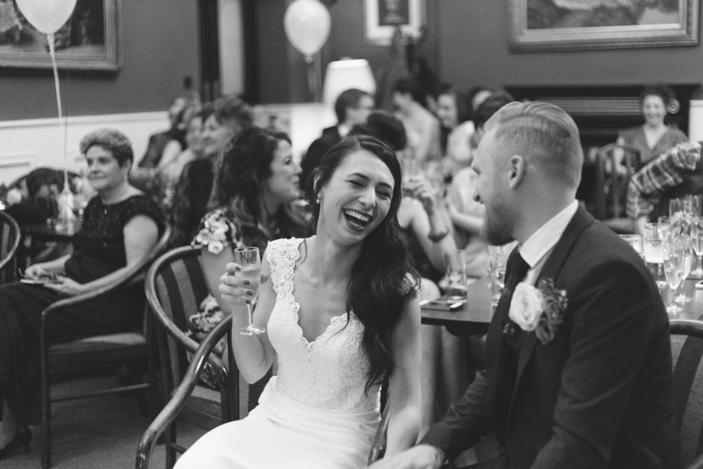 black and white shot of couple laughing