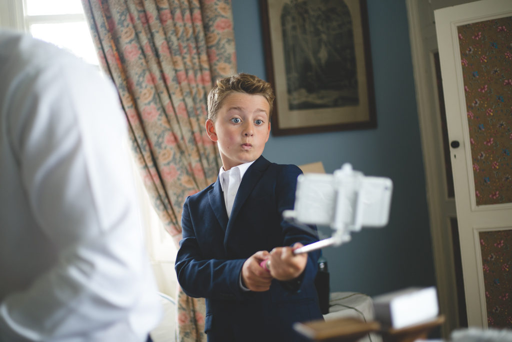 PageBoy taking selfie with selfie-stick