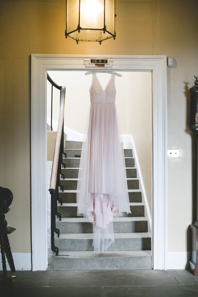 Soft pink blush coloured wedding dress with a sleeveless lace top