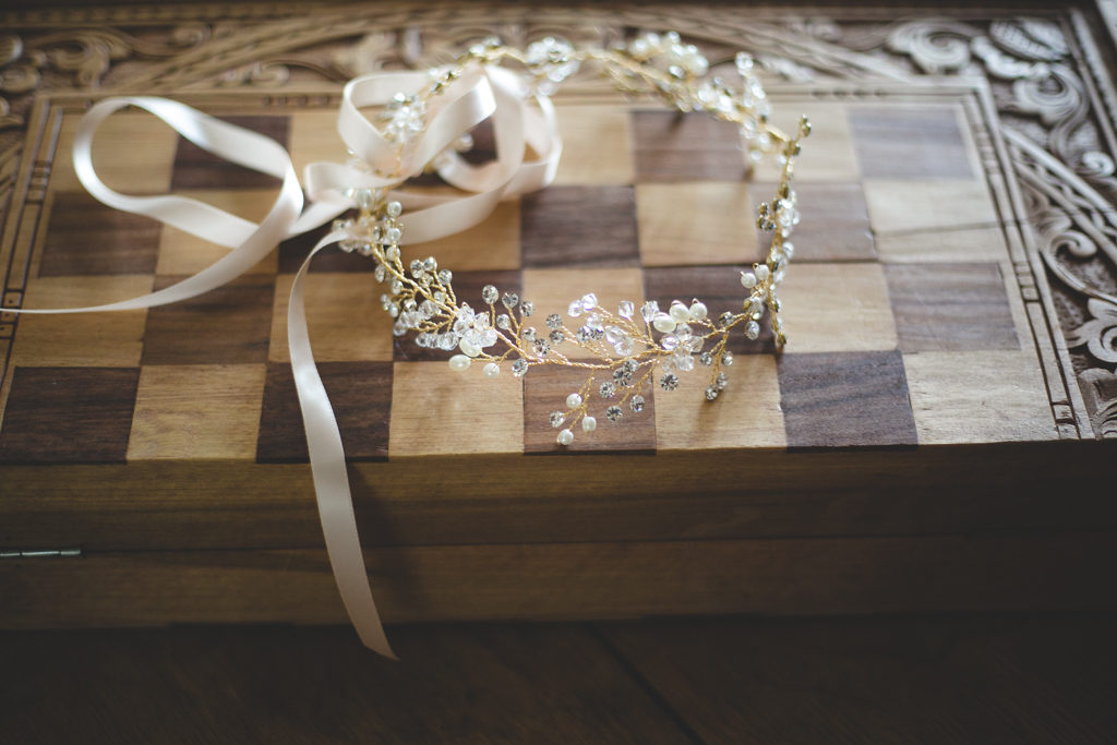 Delicate gold jewel and pearl headpiece with a ribbon tie