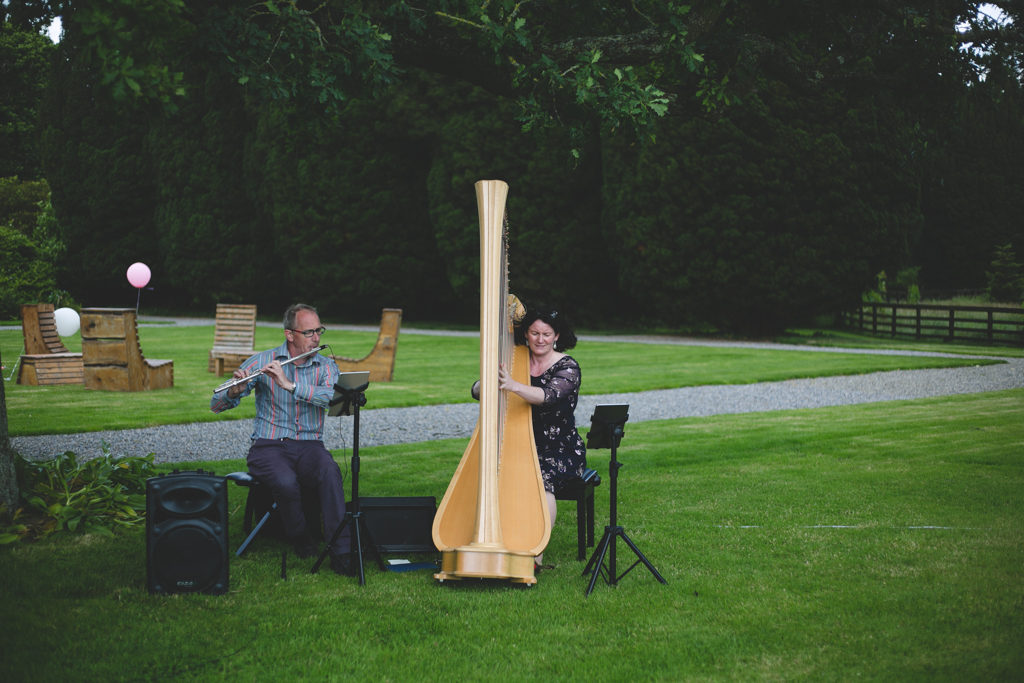 Flautist & harp player performing during the ceremony
