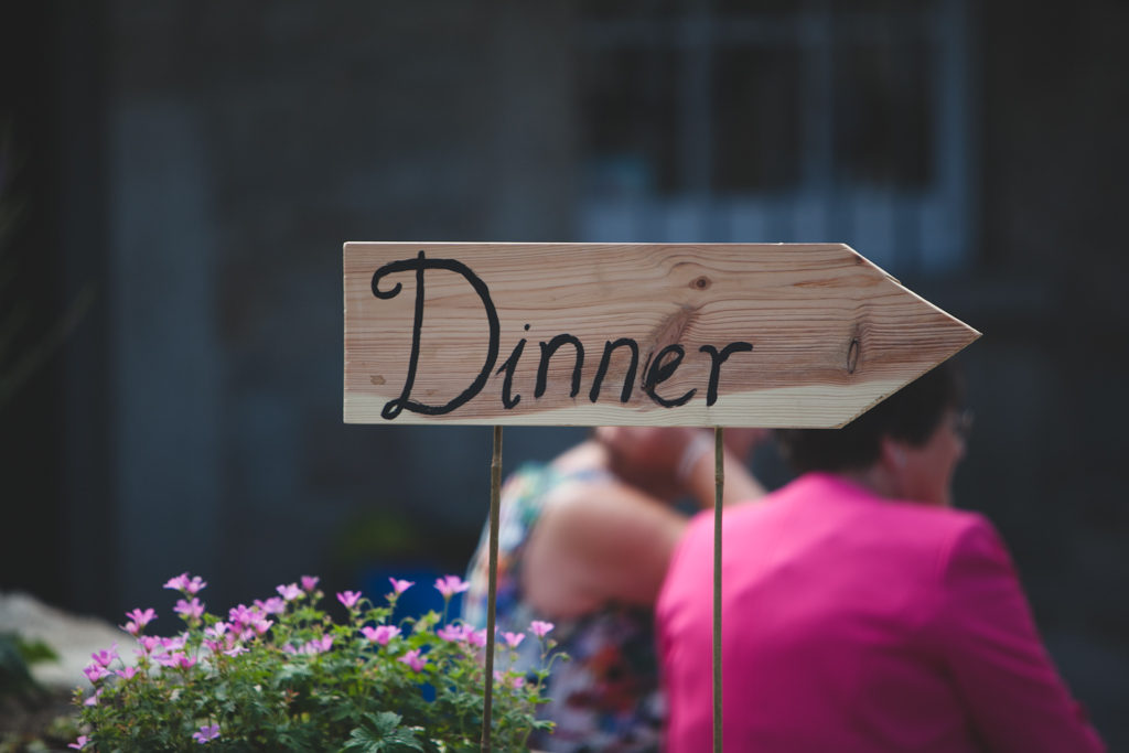 Wooden hand painted 'dinner' sign