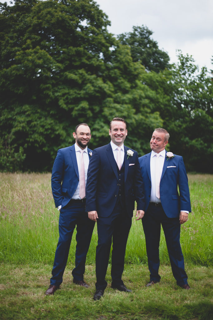 Portrait of a groom and his groomsmen in navy blue suits