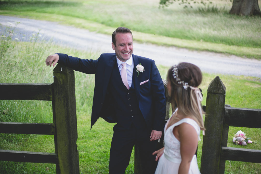 Husband smiles at his new wife