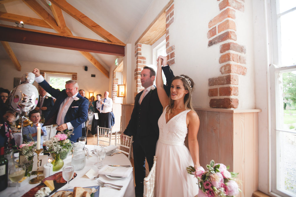 couple cheer as they enter the dining room