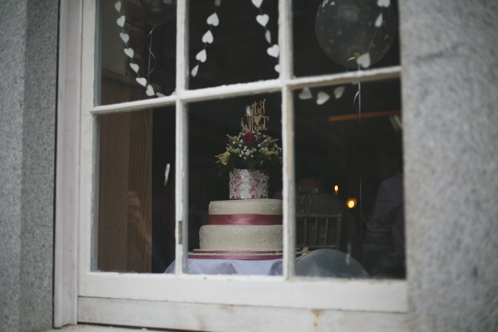 a view of the cake through the window
