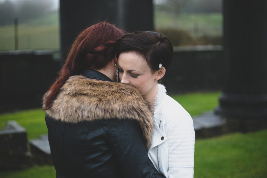 two brides hug at their Winter wedding portrait shoot