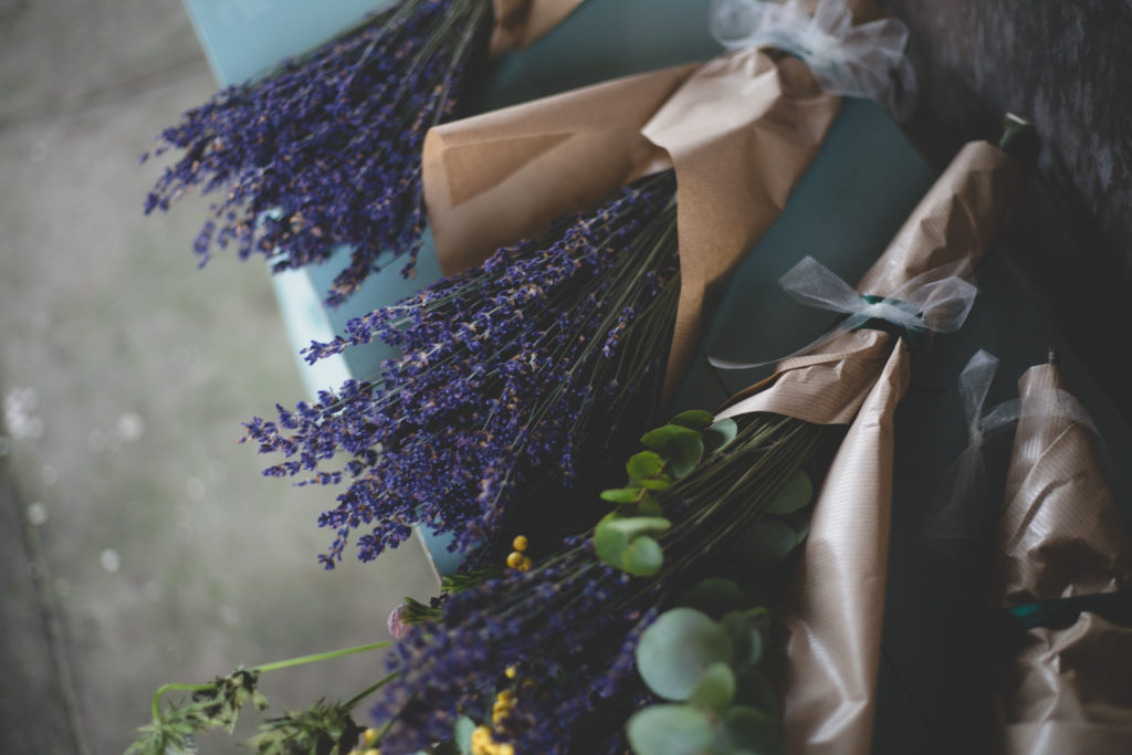 Fresh simple lavender bouquets wrapped in brown paper and white ribbon