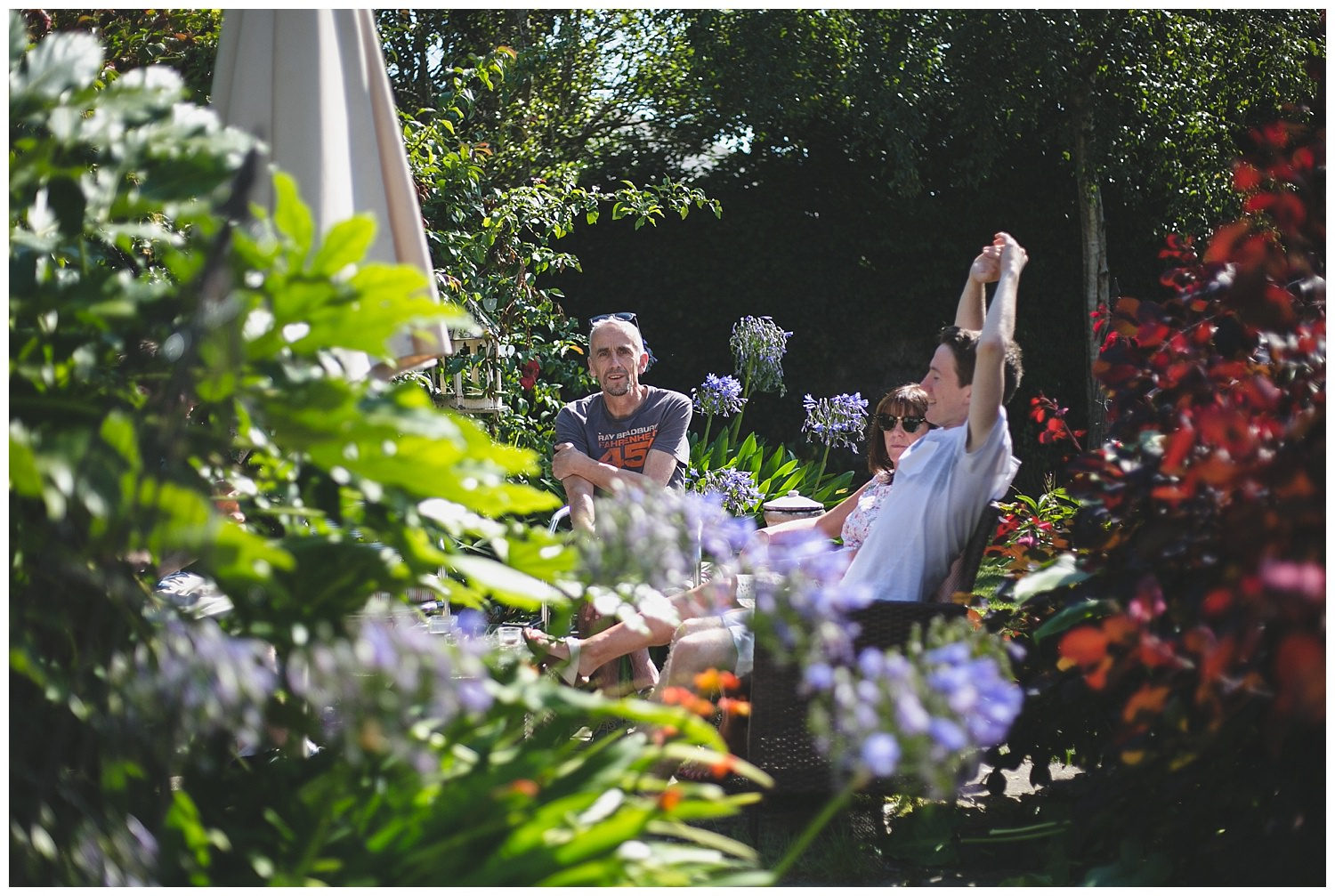 Candid photographs of family in garden