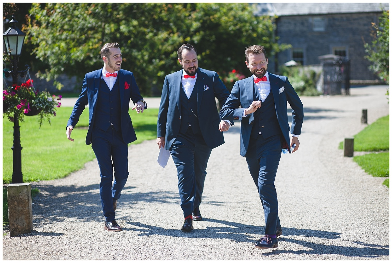 Groom & groomsmen goofing around on the wedding morning