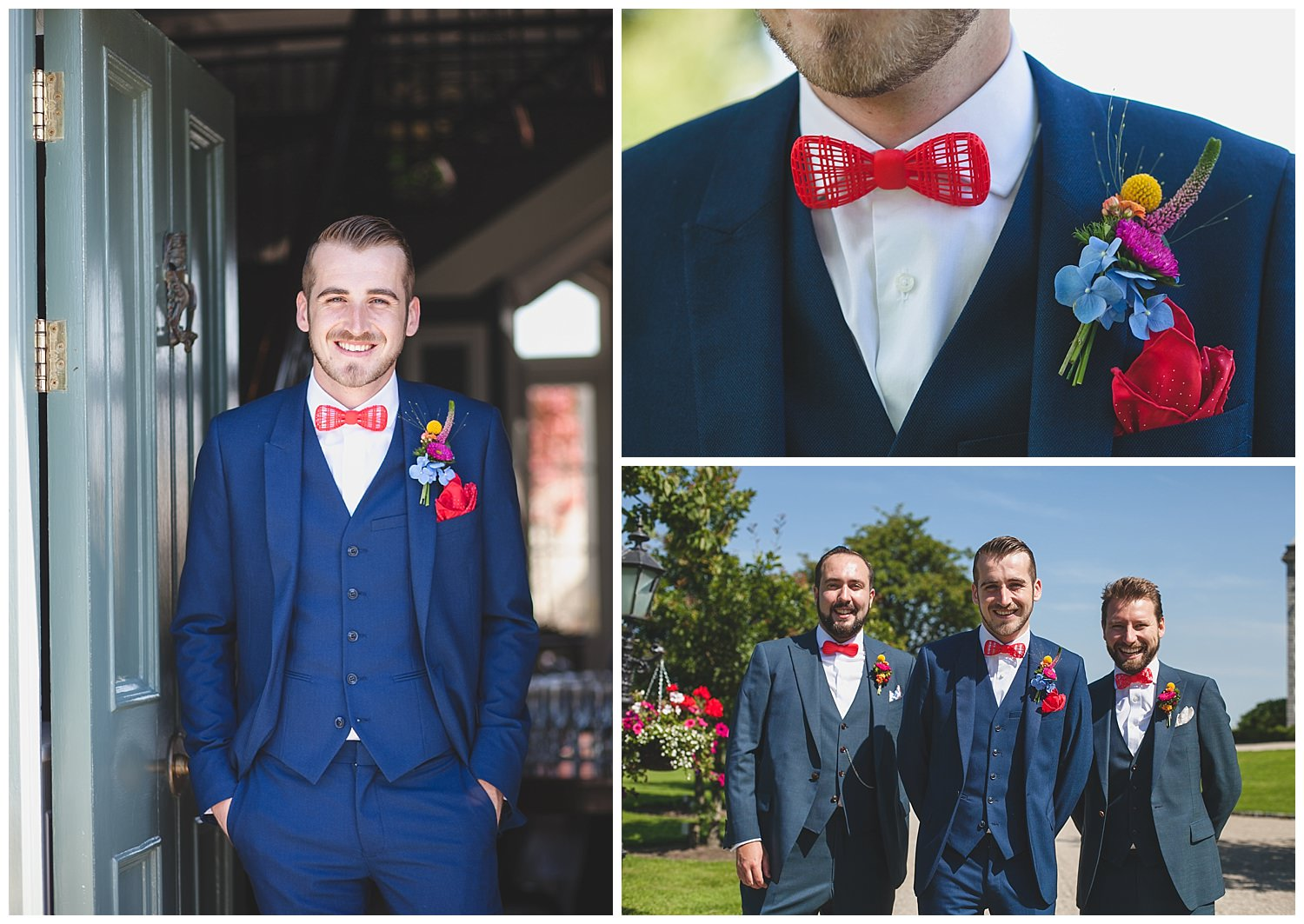 3 piece petrol blue suit with a red bowtie, red cravat and colourful buttoner