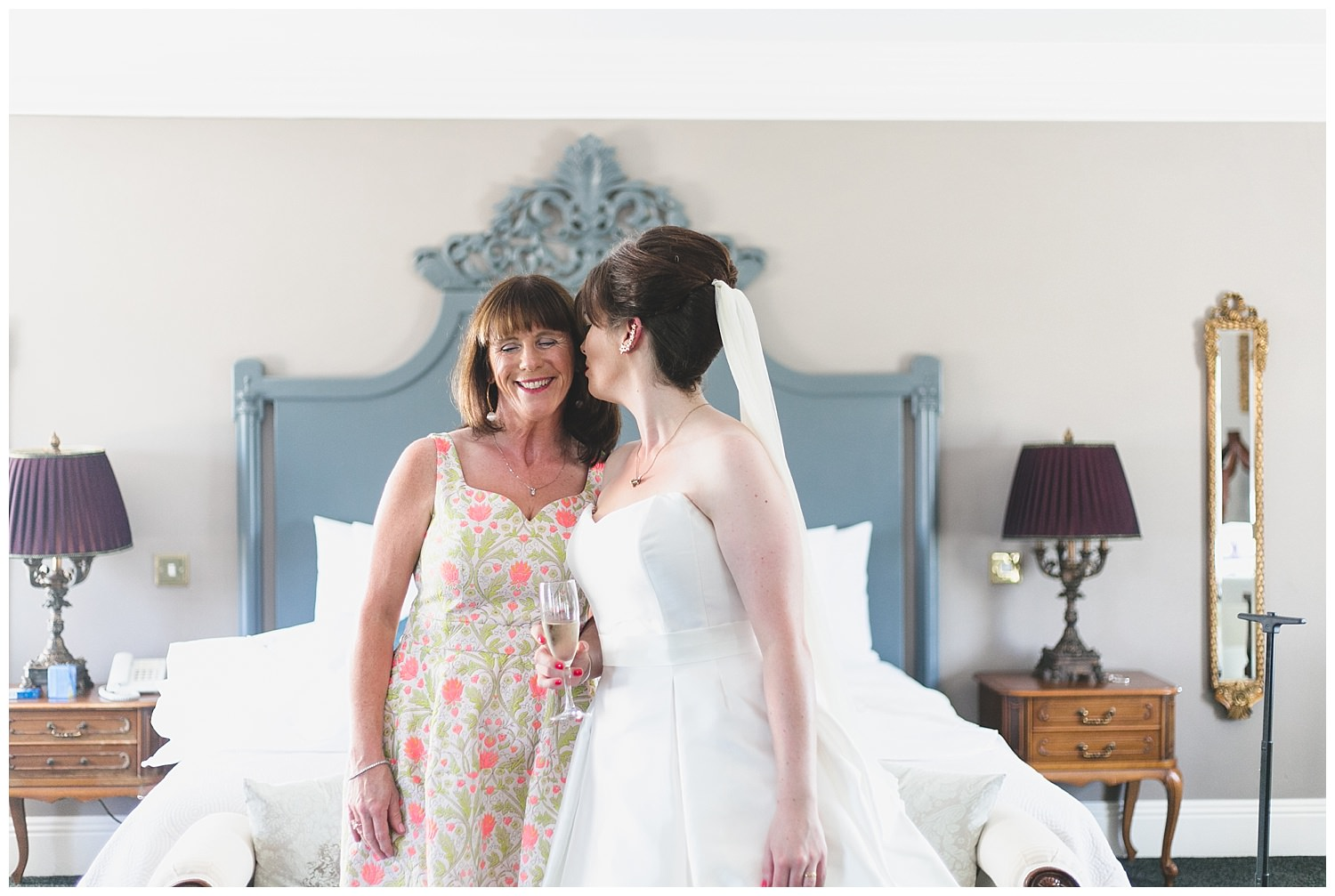 Beautiful moment of Bride kissing her mom