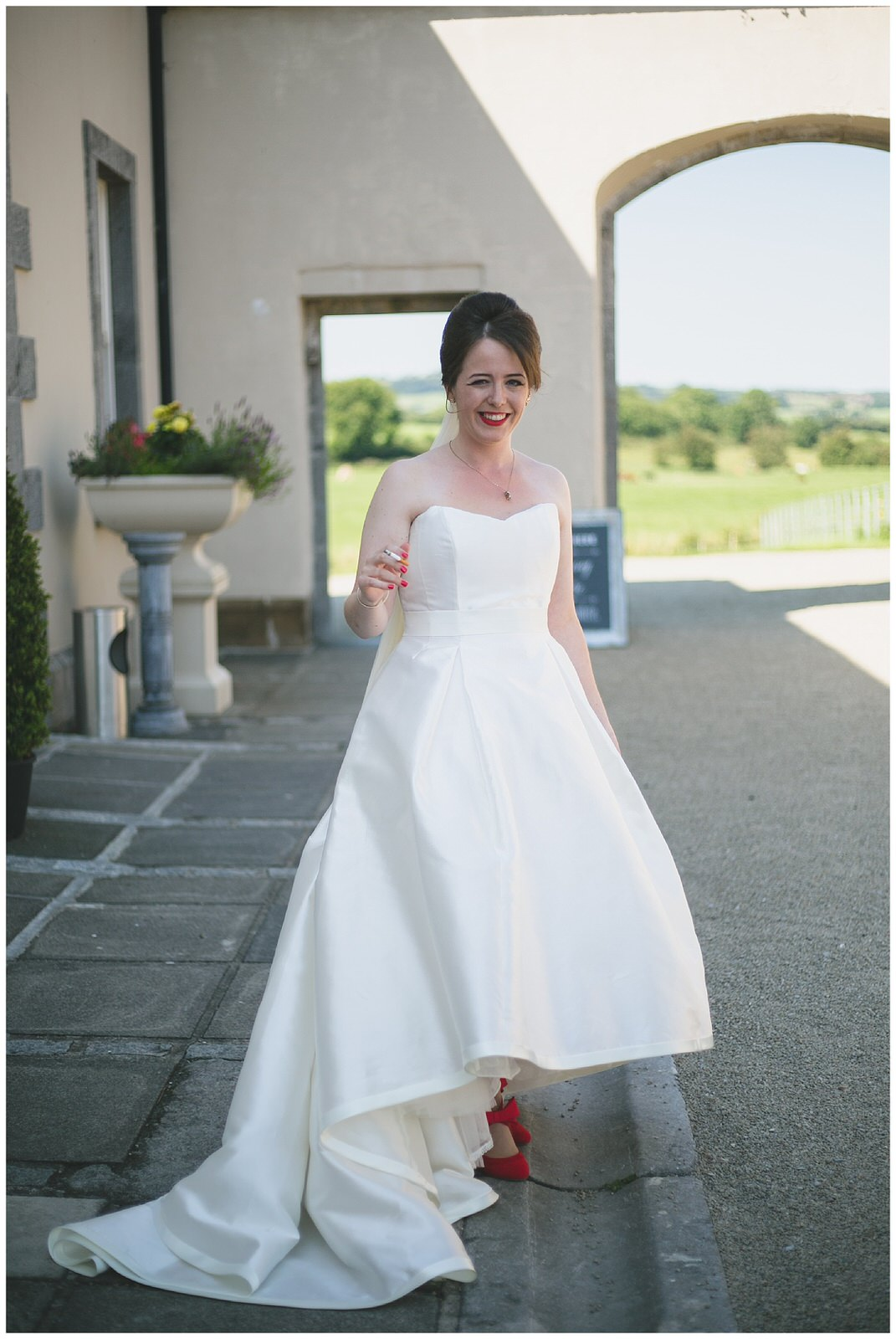 Stunning 3/4 length satin wedding dress with a long train and sweetheart neckline