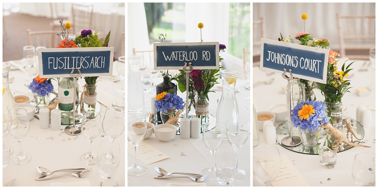 Table sign themed centrepieces with gold dinosaurs