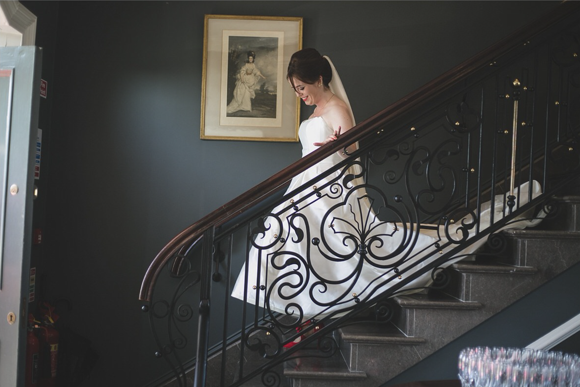 Bride descends the staircase at Clonabreany House