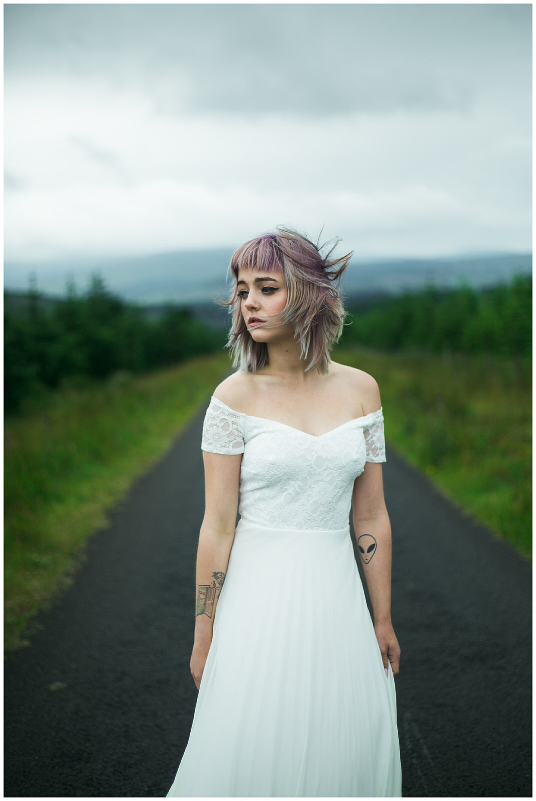 Portrait image of a bride in A full length off the shoulder lace dress from ASOS