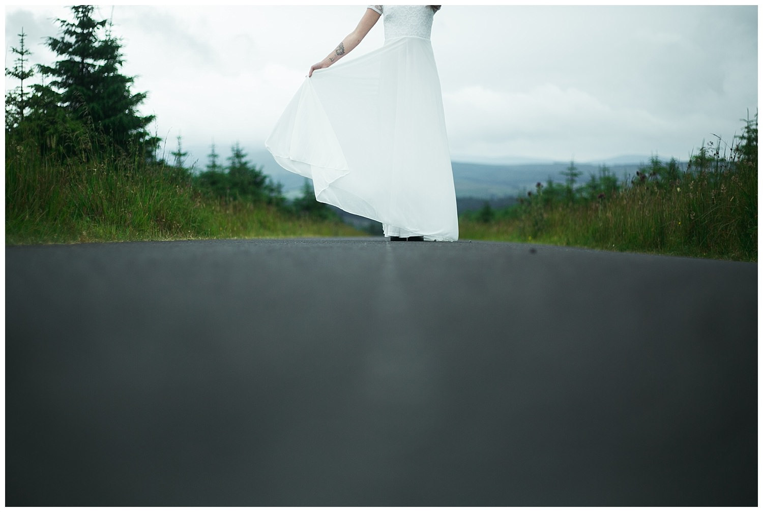 A floor height perspective of a white wedding dress tail