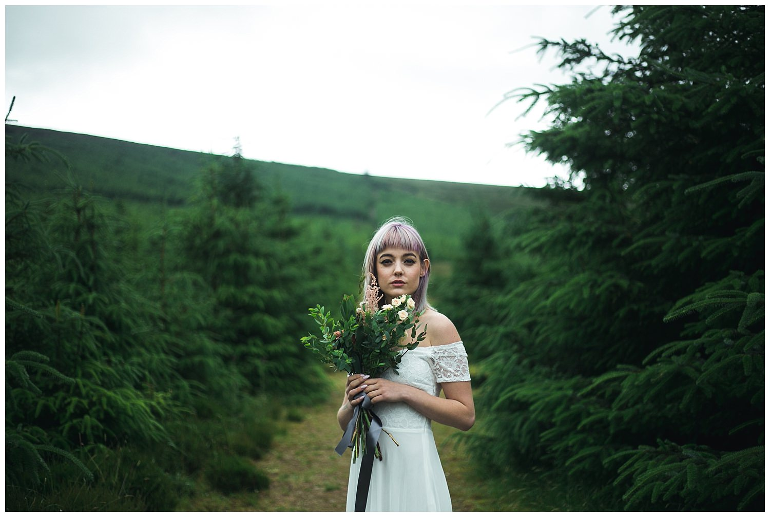 Styled wedding shoot amongst green pine trees in Kippure Wicklow